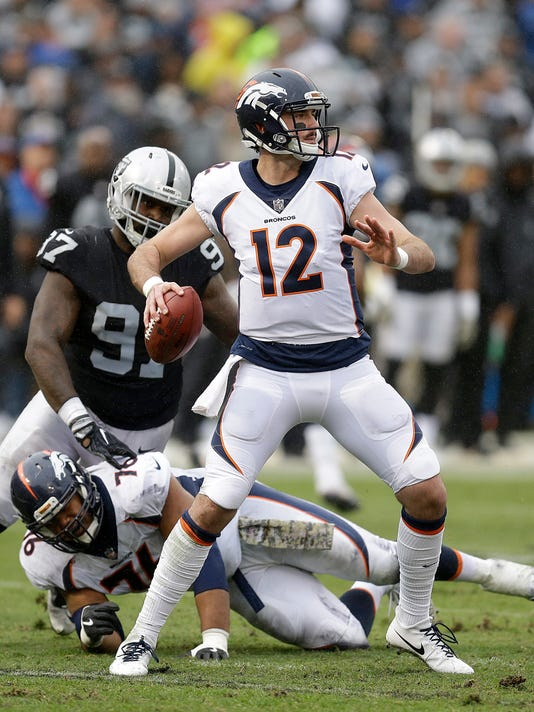 File-This Nov. 26, 2017, file photo shows Denver Broncos quarterback Paxton Lynch (12) passing against the Oakland Raiders during an NFL football game in Oakland, Calif. The Broncos wanted Lynch, their 2016 first-round draft pick who's been a major disappointment, to start last week, too, but he wasn't ready to return from a sprained left ankle he suffered in his only start, at Oakland on Nov. 26, when he spent the fourth quarter sobbing on the sideline after throwing for just 41 yards. (AP Photo/Ben Margot, File)