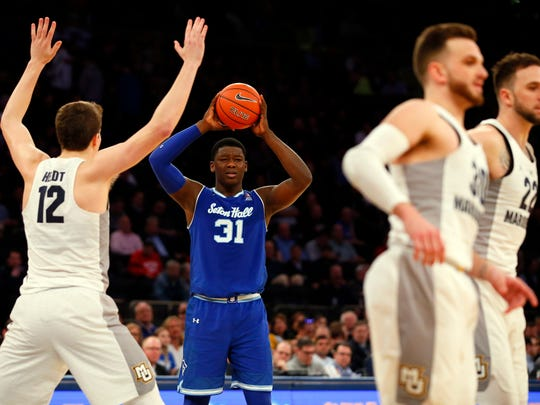 Mar 9, 2017; New York, NY, USA; Seton Hall Pirates forward Michael Nzei (1) looks for help against Marquette Golden Eagles center Matt Heldt (12) during second half of Big East Conference Tournament Quarterfinals at Madison Square Garden. Seton Hall Pirates defeated Marquette Golden Eagles82-76.