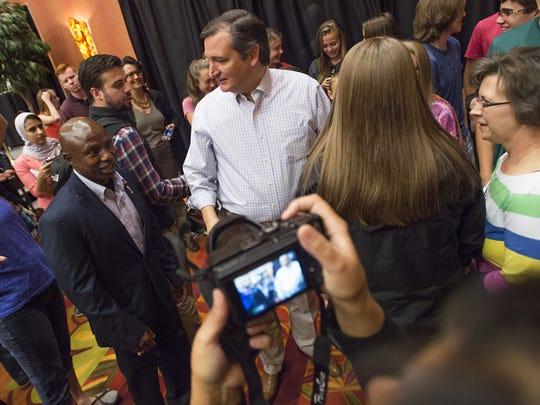 U.S. Senate candidate Darryl Glenn, left, and U.S. Sen. Ted Cruz, center, campaign at the Embassy Suites in Loveland on Wednesday.