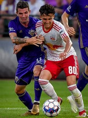 Louisville City FC midfielder Niall McCabe (11) plays against New York Red Bulls II midfielder Chris Lema (80) during the soccer match at Slugger Field in Louisville, Ky, June 30, 2018.