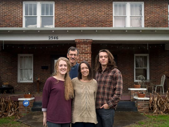 """Tammie Spidell and her family, from right, Stephen and Glen with their neighbor Grace Resha, left, who rents from Gloria Hunter. """"The concept of the H-1 is you invest in the community by investing in the property and really the property is kind of pitted against the people that are here,""""  Spidell said. """"And they'll say this is community development, but in actuality, I don't think of community as being property."""""""