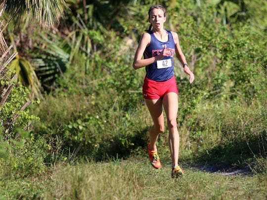 Estero's Alayna Goll runs in the Class 3A-12 district