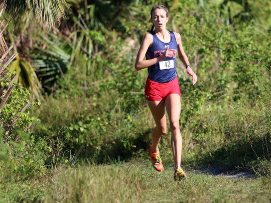 Estero's Alayna Goll runs in the Class 3A-12 district meet at Palmetto Ridge High School on Thursday, Oct. 26, 2017.