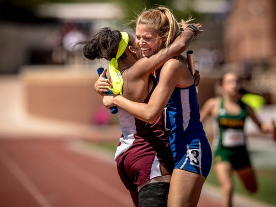 Vernon's Rayah Coleman hugs Graham's Rosie Schaffer after the Lady Lions and Lady Blues went 1-2 in the girls 4x200 relay.