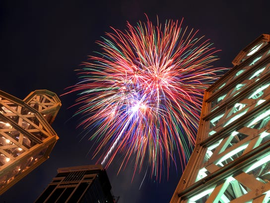 """America's Independence Day ended with a fireworks show from the Regions Bank Freedom Blast explode over the downtown skyline and over the Viewfinders sculptors by Eric Nordgulen Friday evening on Mass Ave. About 3000 were launched into the airover downtown Indianapolis Friday night. (Matt Kryger / The Indianapolis Star) <b>07/01/2010 - H10 - MAIN - 1ST - THE INDIANAPOLIS STAR</b><br />When Francis Scott Key wrote about """"bombs bursting in air,"""" he probably didn't figure on there ever being fireworks displays like the annual Freedom Blast at Regions Bank in Downtown Indianapolis. The Sunday night show is synchronized to music on WFBQ-FM (94.7)."""