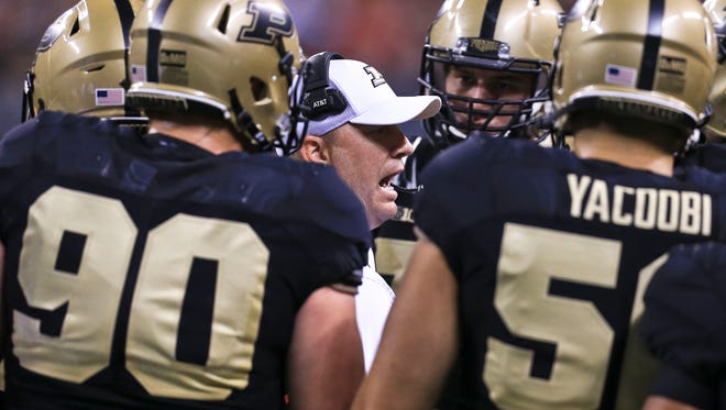 Purdue's Jeff Brohm talks to this team during a timeout in the 35-28 loss to Louisville at Lucas Oil Field Sept. 2 in Indianapolis.