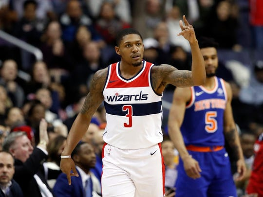 Washington Wizards guard Bradley Beal (3) reacts after his 3-point shot during the first half of an NBA basketball game against the New York Knicks, Wednesday, Jan. 3, 2018, in Washington.