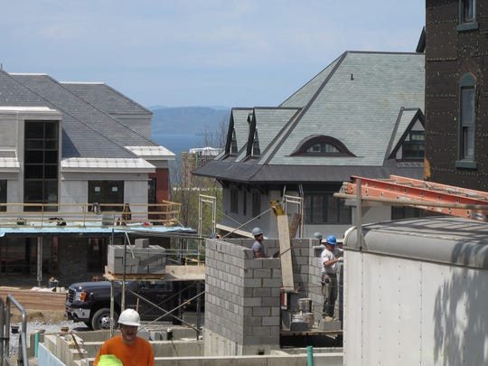 "A new, diverse skyline takes shape in Burlington with construction of Champlain College's ""Tri-Res"" dorms."