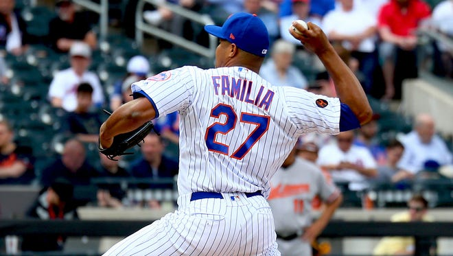 New York Mets losing pitcher Jeurys Familia (27) pitches against the Baltimore Orioles during the eighth inning at Citi Field.