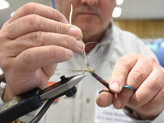 British angler Chris Reeves ties French Partridge Mayfly