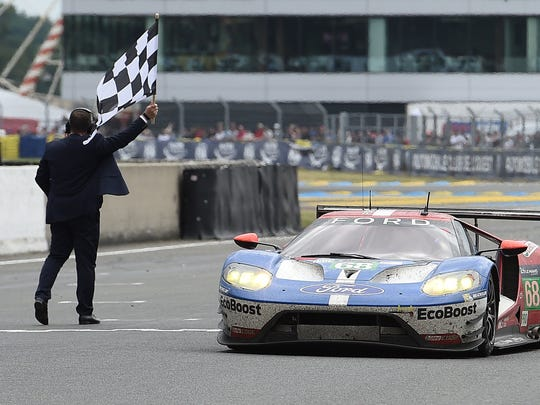 Dirk Mueller crosses the finish line on his Ford GT 68, to win the LMGTE PRO category of the 84th Le Mans 24-hours endurance race on June 19, 2016 in Le Mans, France.