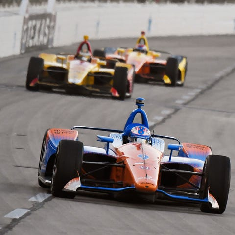 Scott Dixon, of New Zealand, heads into Turn 1...