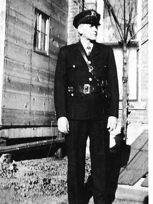 "A photo of Indianola's night policeman, William Elvin ""Pop"" Hickman, in his uniform."