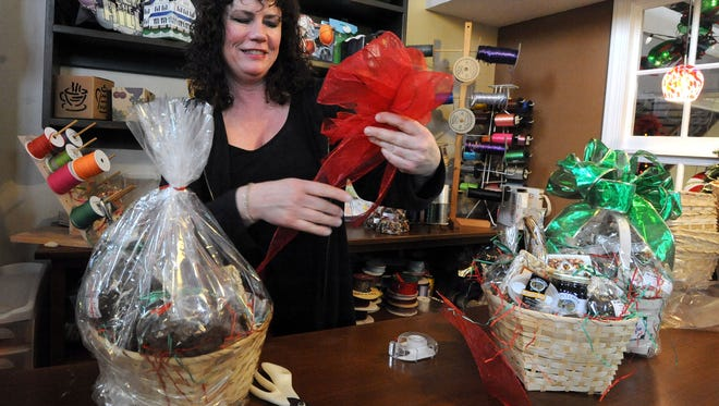 Jody Lackey, owner of The Candy Shack, is pictured in this 2015 file photo.  She said her business has been helped recently by an online group encouraging Marion residents to spend their money locally.