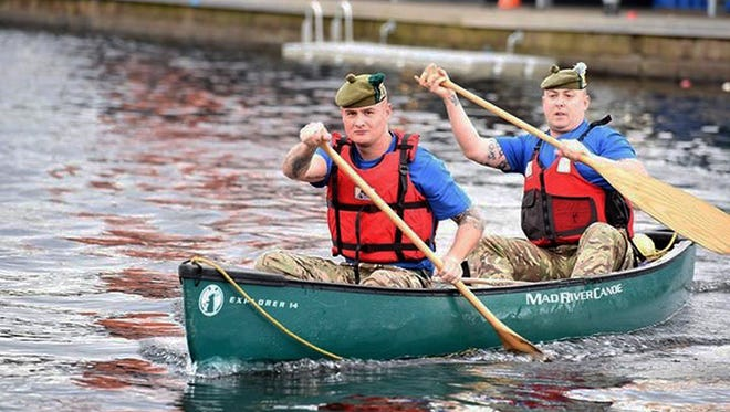 Pvt. Ryan O'Malley, foreground, and Color Sgt. Jim Gould of the Royal Regiment of Scotland paddle a canoe at the Pinkston Water Sports Complex in Glasgow, Scotland, July 28, 2016. Starting Aug. 30, 2016,  they and 14 others began travel from Montreal to Yonkers to New York City by canoe, along lakes and rivers where their military forebears fought and died during two 18th-century wars.