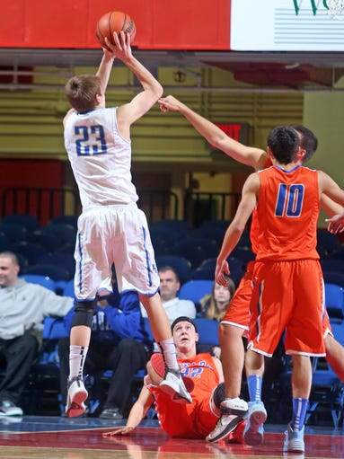 Haldane's Peter Hoffman shoots over Seward's Tim Fuller, who had fallen to the floor, during a Class C regional semifinal basketball game at the Westchester County Center in White Plains March 4, 2014. Haldane defeated Seward 61-54.