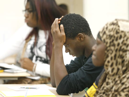 James Weh works on solving a problem in a geometry class during the Rochester City School District summer school program at Edison Technology Campus on July 23, 2015.