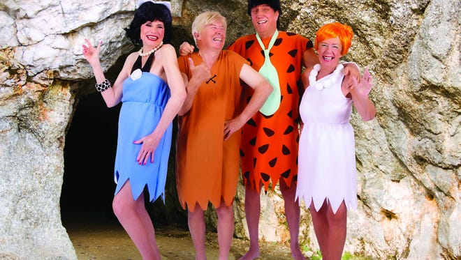 Inspired by The Flintstones, Charlotte Nossaman poses as Betty, Elmer Nossaman as Barney, Roger Yadro as Fred and Kitty Yadro as Wilma