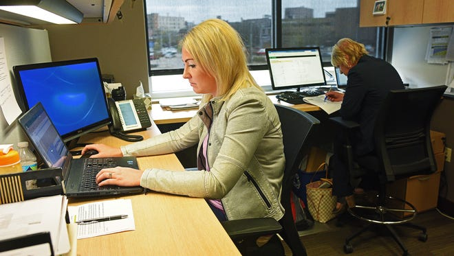 Ashley Lipp, left, who is working and training to be a vice president of property management at Lloyd Companies, shares an office with current vice president of property management, Christie Ernst, right, Thursday, April 27, 2017, at Lloyd Companies in Sioux Falls.