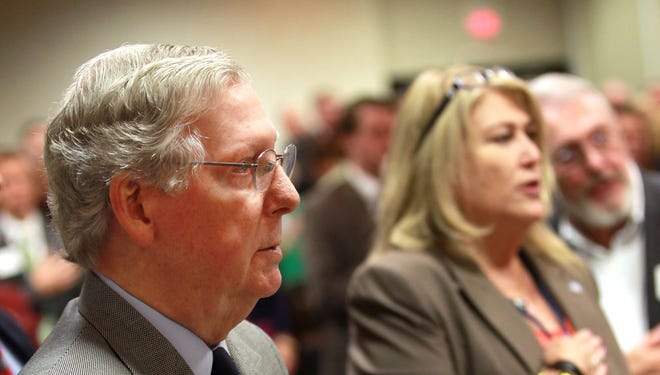 Sen. Mitch McConnell (R-KY)  recites the Pledge of Allegiance at  the Northern Kentucky Area Development District's (NKADD) annual meeting at the Hilton in Florence.  He was among the speakers at the event.