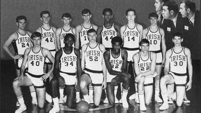 The 1969 Spalding Irish, who finished second in the IHSA state tournament and were led by Alvin O'Neal. In the picture: Kneeling (left to right) are Dave Scovil, Skeet Barksdale, Ken Wolbeck, Alvin O'NeaI, Skip Thorell, and Rich Lavin. Standing are Rick Schaidle, Marty McGann, Tom Morrisey, Art Jenkins, Jimmie Moore, Steve Schrader, Tom Crotz. Inset at top right corner are Coach Bradle, Coach Dwyer, Coach Patterson.