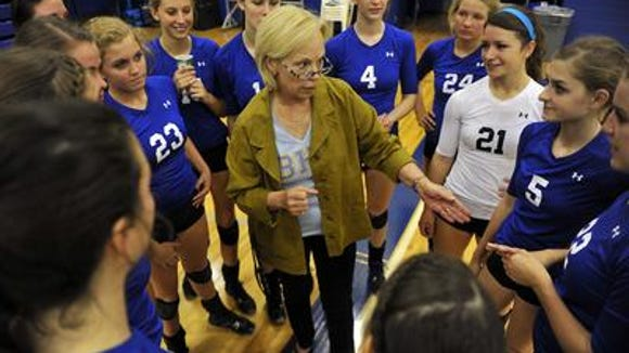 Brentwood volleyball coach Barbara Campbell, center