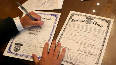 Missouri judge signs marriage license for same-sex couple at St. Louis City Hall.