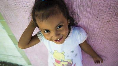 Child in gang-controlled neighborhood in San Salvador, El Salvador
