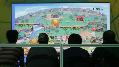 "Show attendees play the ""Super Smash Bros"" video game at the Nintendo booth at the Electronic Entertainment Expo on Tuesday in Los Angeles."