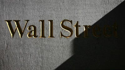 In this Monday, March 8, 2010, file photo, a sign for Wall Street is shown near the New York Stock Exchange. World stock markets struggled for direction Tuesday, June 24, 2014, after Wall Street fell for the first time in seven days, in a possible sign that investors were pausing to re-evaluate the market's recent highs.