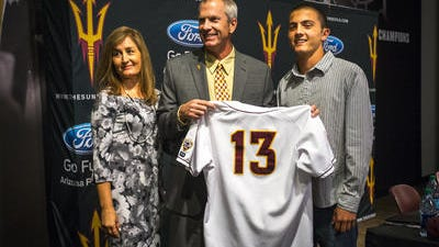 New ASU baseball coach Tracy Smith with his wife Jaime and youngest son Jack.