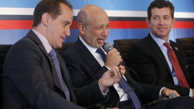 From left, Randy Garutti, chief executive officer of Shake Shack, Lloyd Blankfein, chairman and chief executive officer of Goldman Sachs, and Alex Gorsky, chief executive officer of Johnson and Johnson, participate in a session entitled: Talent Attraction and Retention, Monday, June 23, 2014, at The White House Summit on Working Families in Washington. Johnson & Johnson (JNJ) on Tuesday reported earnings that climbed by 13 percent in its second quarter, and topped analysts' expectations.