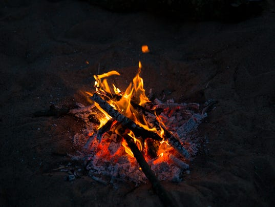 small fire disperses the darkness on a picnic in the countryside