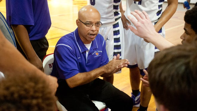 Southern Trojans head basketball coach Shedrick J. Jones, Jr. talks to his players during a time-out in the 2015 Wes Unseld Classic at Seneca High School.