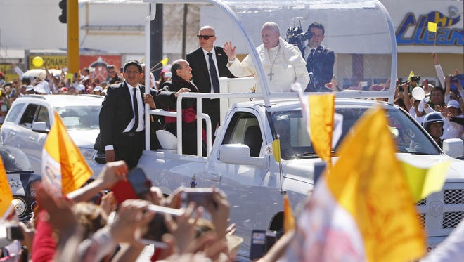 Pope Francis passes by a crowd of people on Wednesday, Feb. 17, 2016, in Juárez, Mexico.