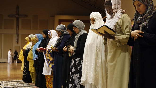 Members of the Memphis Islamic Center pray at Heartsong Church in Cordova, Tenn., in 2010. The struggle between the Islamic Center of Murfreesboro and its opponents paints a distorted picture of Muslim life in Tennessee.  AP FILE - In this Aug. 23, 2010 file photo, members of the Memphis Islamic Center pray at Heartsong Church in Cordova, Tenn., a suburb of Memphis, Tenn. while their mosque is under construction nearby. When mosque leaders realized their building would not be completed in time for the holy month of Ramadan, Heartsong stepped in and opened its sanctuary every night to its Muslim neighbors. The struggle between the Islamic Center of Murfreesboro and its opponents since 2010 paints a distorted picture of Muslim life in Tennessee. Over the same period, new mosques have opened in Memphis, Chattanooga, Nashville and other cities with little or no controversy. (AP Photo/The Commercial Appeal, Nikki Boertman, File)