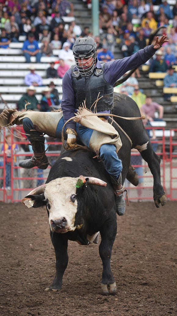 PRCA bull rider Tate Thybo, from Belle Fourche, South Dakota, participates in the PRCA Rodeo Monday, Aug. 13, at the Sioux Empire Fair in Sioux Falls.