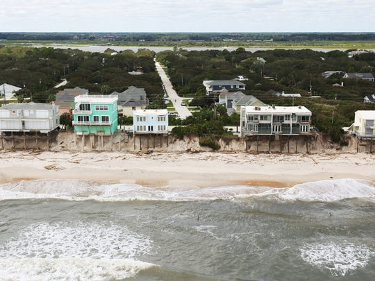 Beach erosion from Hurricane Matthew can be seen along the St. Augustine coast a day after the October storm tore through the area.