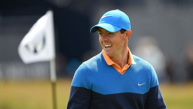 In a file photo from July 12, 2016, Rory McIlroy reacts during a practice round for the 145th Open Championship golf tournament at Royal Troon Golf Club - Old Course.