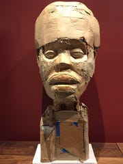 "Artist Stephen Flemister's cardboard and wood sculpture ""Portrait of A Thismia"" is part of the exhibit ""#BlackArtMatters"" at the Carnegie Center for Art and History."