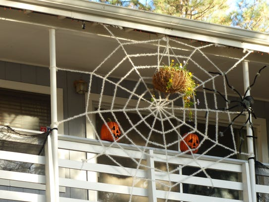 A giant spider web decorates one home in Ruidoso.