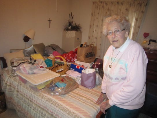"""Betty Chirhart in what she calls her """"hoarder's room."""""""