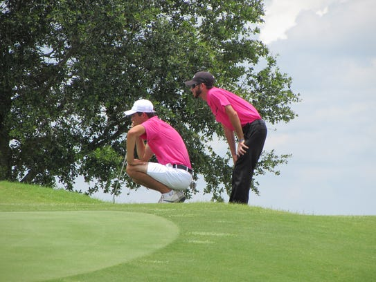 Eastern Florida's Brad Bawden lines up a putt on the