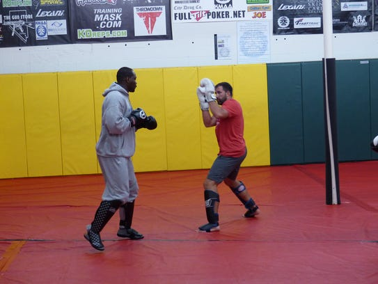 Ovince St. Preux spars with Terry Bullman, a retired