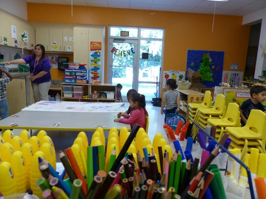 Kids get ready for snack time inside the early education