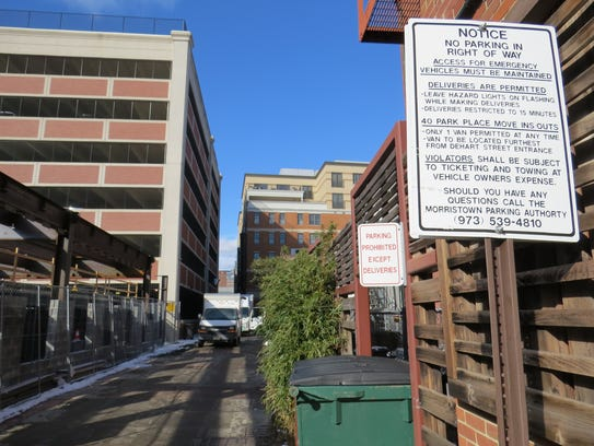 Signs limit use to the back alley behind South Street