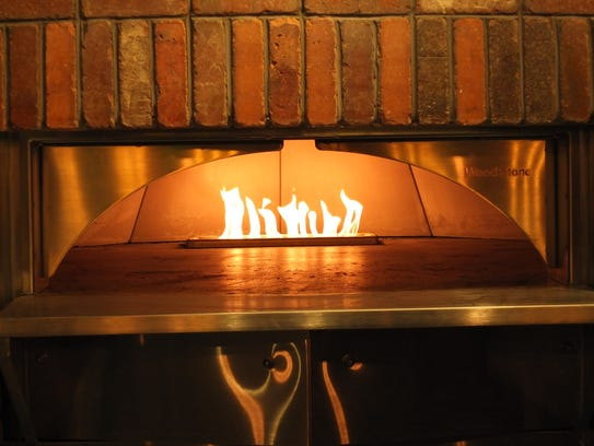 The Explorium Brewpub in Southridge Mall has a flame