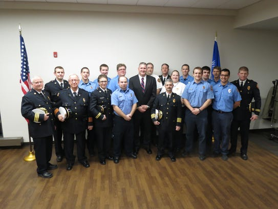 Newly appointed Fire Chief David Johnsen (center) and