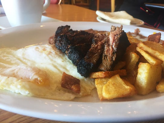 Steak and eggs ($12) comes with two eggs, Manhattan-cut,