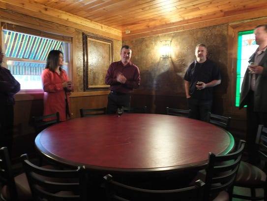 Shawn Vollmer (center), founder of Three Cellars, explains